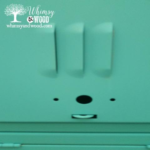 smiling painted metal locker face