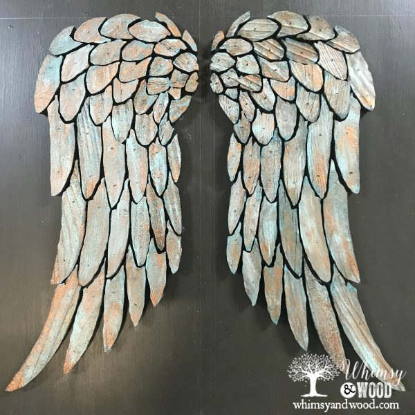 close up copper patina angel wings