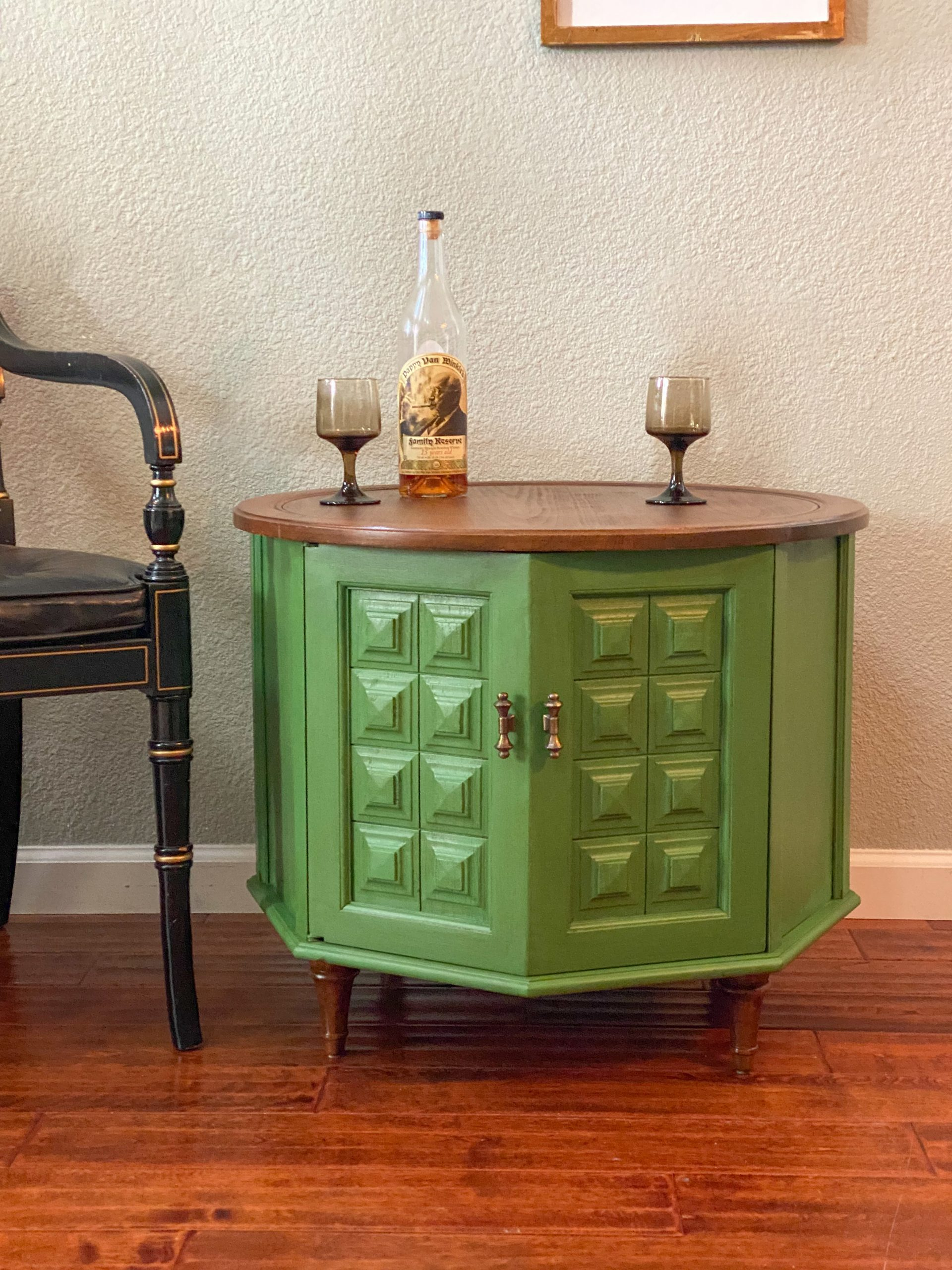 The cutest little vintage side table painted Dublin Green with a Chestnut stained top and feet.